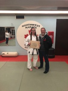Sempai Ashley receiving Nidan Certificate  from Shihan Meagher